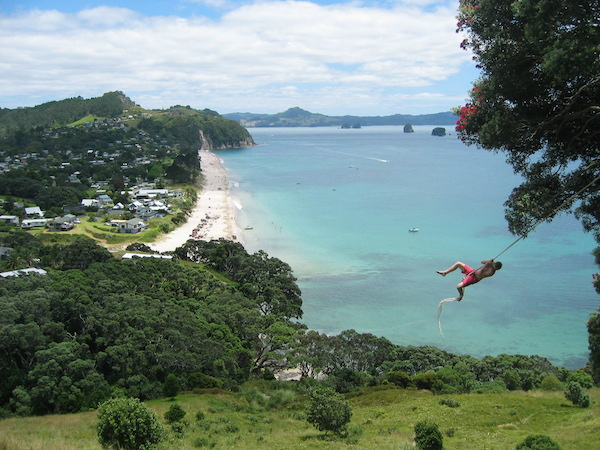 My son on a rope swing above Hahei Beach, Coromandel Peninsula, on Christmas Eve.